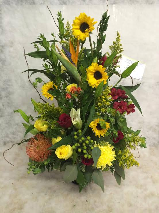 A celebration in yellow from Hobby Hill Florist in Sebring, FL