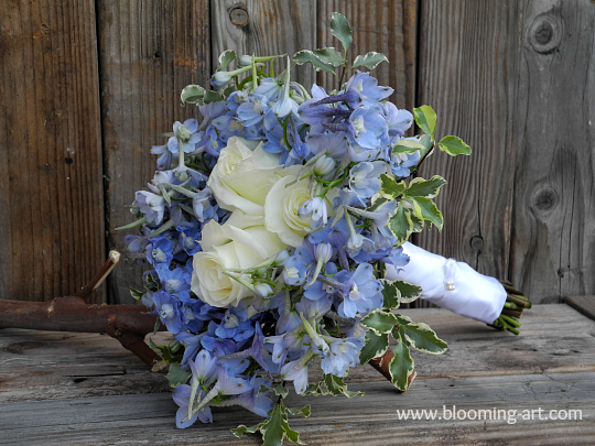 Blue and white winter wedding bouquet from Blooming Art Floral Design in San Diego, CA