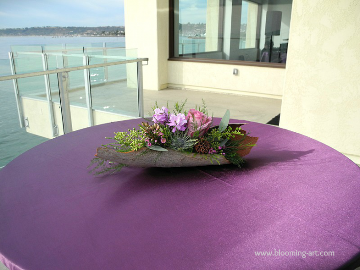 Extremely creative cocktail table arrangment from Blooming Art Floral Design in San Diego, CA