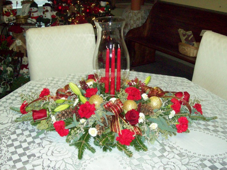 Lovely holiday centerpiece by Com-Patt-ibles Floral Elegance in Wooster, OH