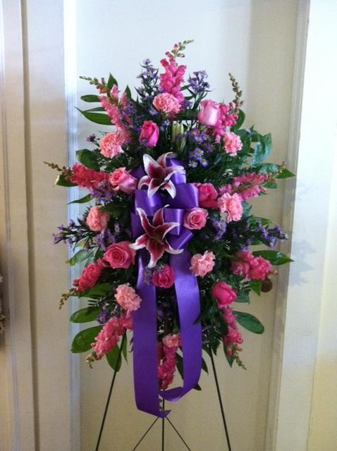 An impressive funeral spray from The Cottage Florist in Riverview, FL