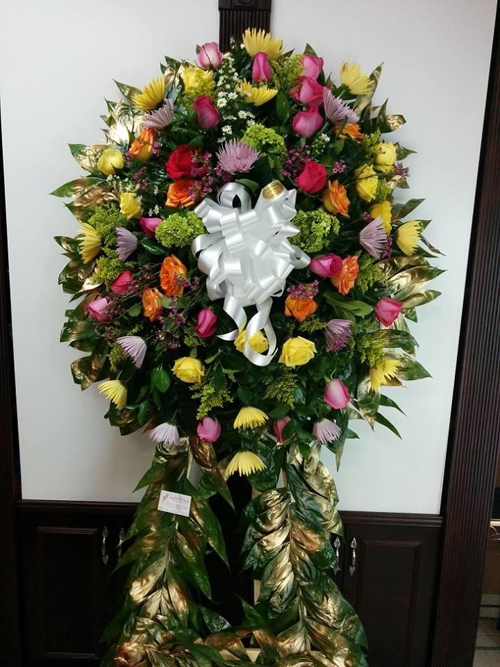 Elegant standing spray from Fancy Flowers & Gift Shop in Hialeah, FL