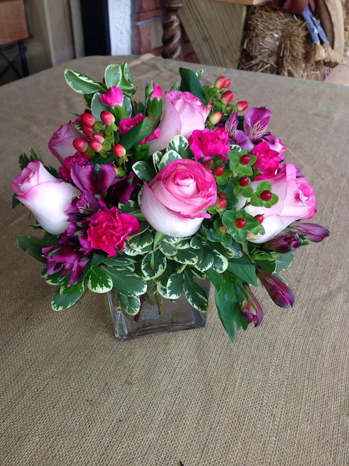 Pinks and purples in a cube from Dorothea's Florist in Hobe, FL