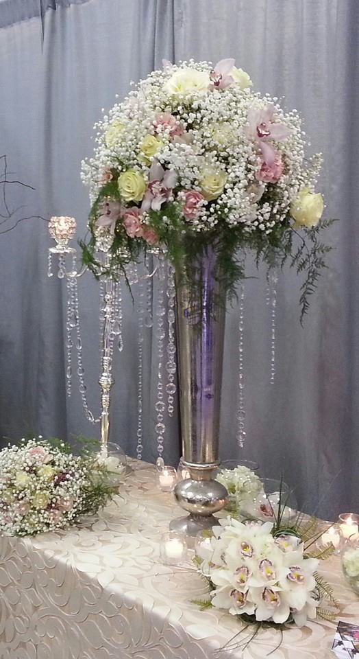 A classic wedding table arrangement from Sweet Pea's Floral in Woodbury, MN