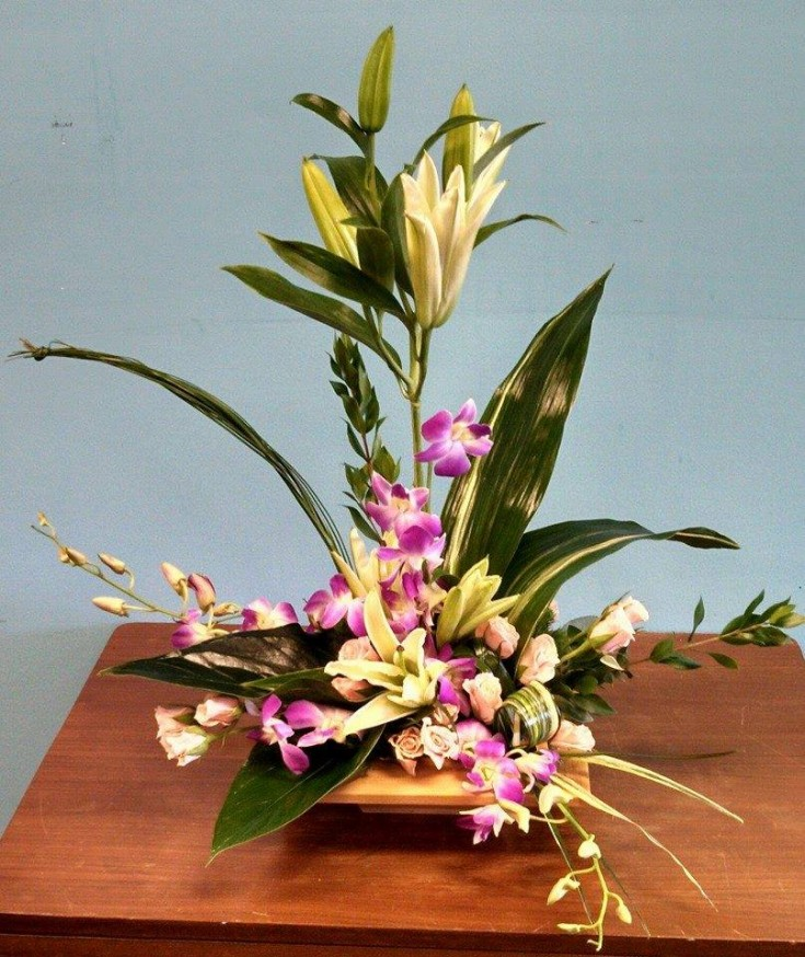 A creative piece from DEEP ROOTS Floral & Wedding Design, Tanning, Gifts in Grovetown, GA