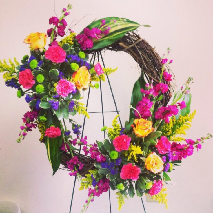 A vibrant sympathy wreath from Bev's Floral and Gifts in Parowan, UT
