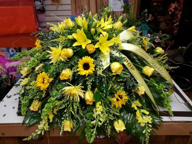 An amazing casket spray from Carthage Flower Shop in Carthage, TX