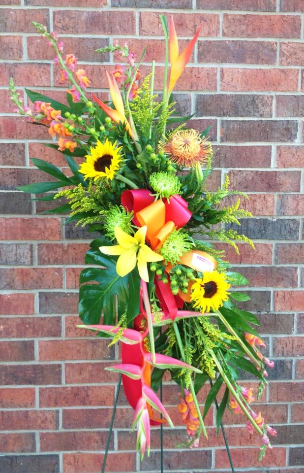 Easel design by A New Beginning Florist in Moore, OK