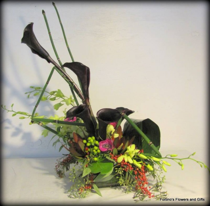 Elegant and creative arrangement from Fortino's Flowers and Gifts in Pontiac, MI