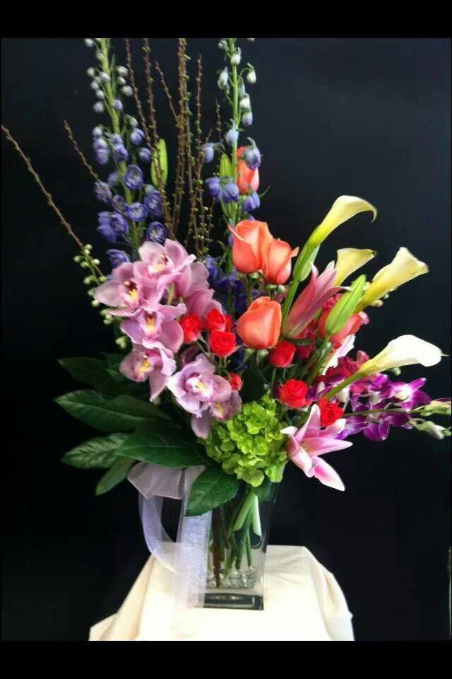 A tall spring vase arrangement from Robyn at Flowers and More in Fresno, CA