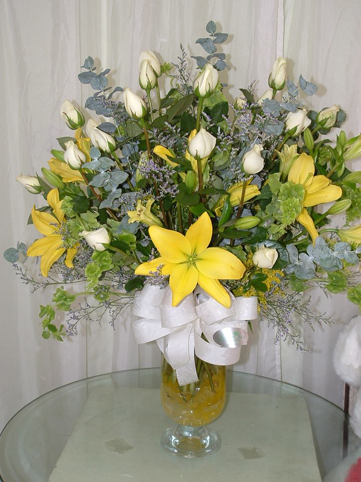 Beautiful yellow and white arrangement from Divine Ideas and Flowers for You in Edinburg, TX