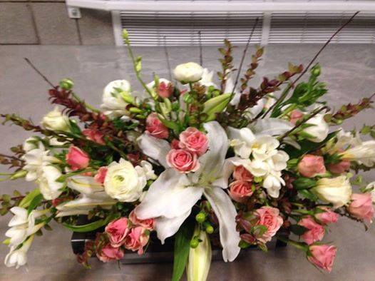 Centerpiece for the Utah Valley University's Presidents table by Cary's Designs Floral in Spanish Fork, UT