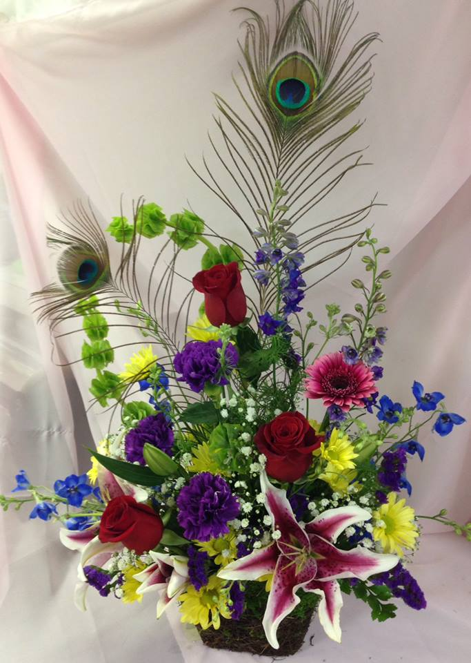 Designing around peacock feathers at Michele's Floral and Gifts in Copperas Cove, TX