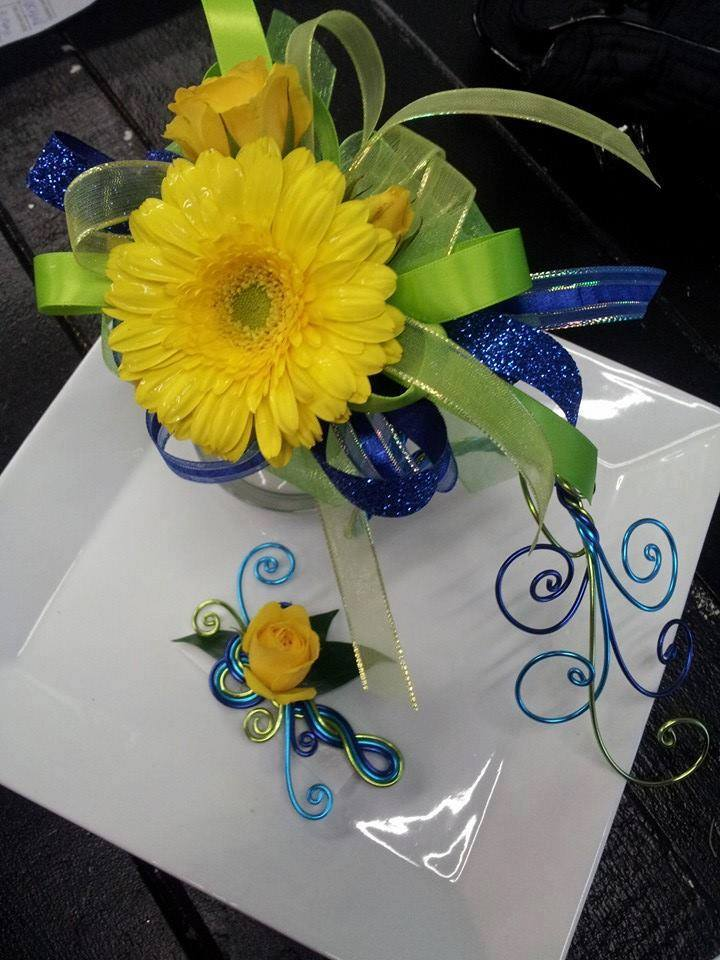 Serpintine armband with corsage and coordinating boutonniere from Designs by Vogt's Floral & Gifts in Sturgis, MI