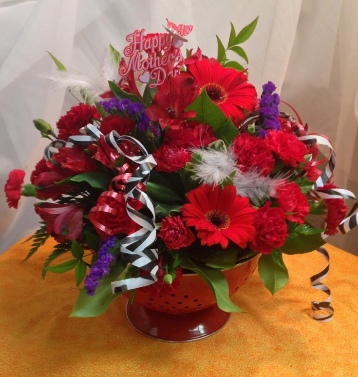 A one-of-a-kind floral display in a keepsake container from Michele's Floral and Gifts in Copperas Cove, TX
