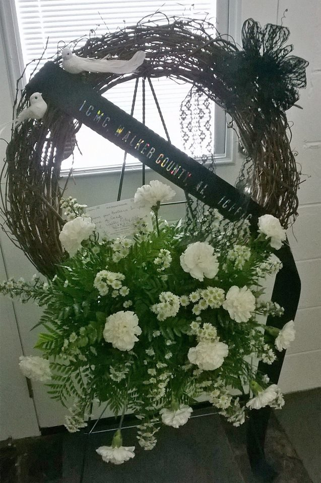 White doves adorn this sympathy wreath from Wilma's Flowers in Jasper, AL