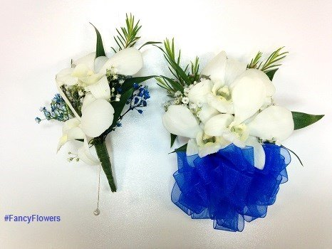 White orchid corsage and boutonniere from Fancy Flowers & Gift Shop in Hialeah, FL