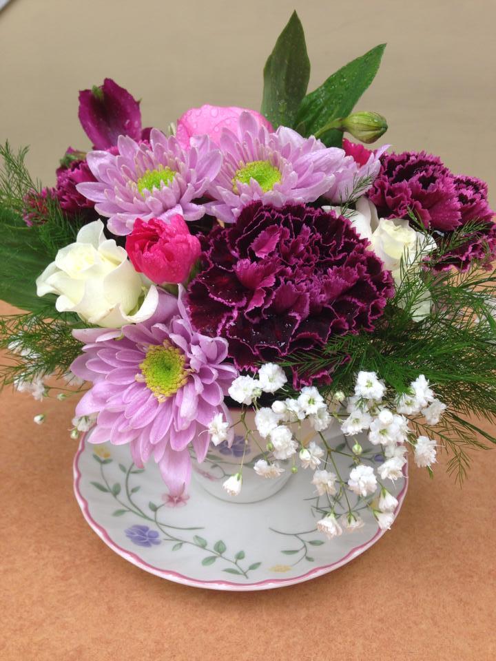 A teacup arrangement from Oak Bay Flower Shop Ltd. in Victoria, BC