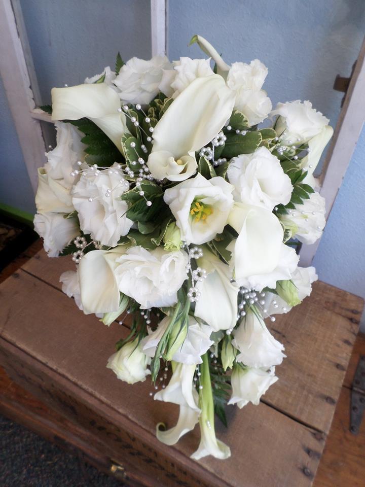 A vintage wedding teardrop bouquet from Klamath Flower Shop in Klamath Falls, OR