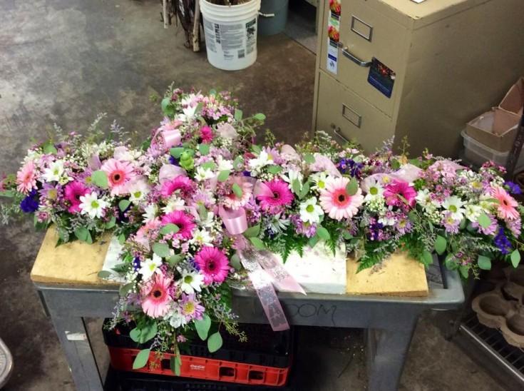 Cross shape casket spray from Brenham Floral Company in Brenham, TX