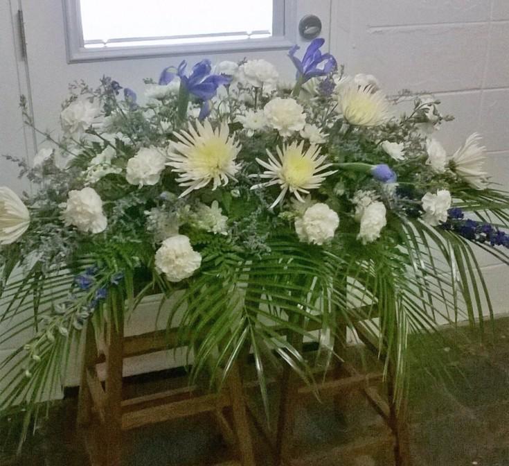 Wonderful casket spray from Wilma's Flowers in Jasper, AL