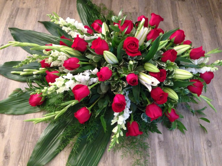 Breathtaking casket spray from Petals in Thyme of Wasaga Beach, ON