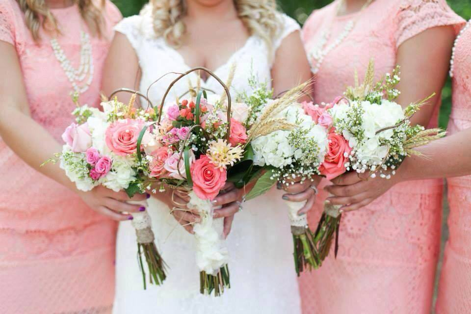 The bridal party with floral beauty from The Flower Shop in Pryor, OK