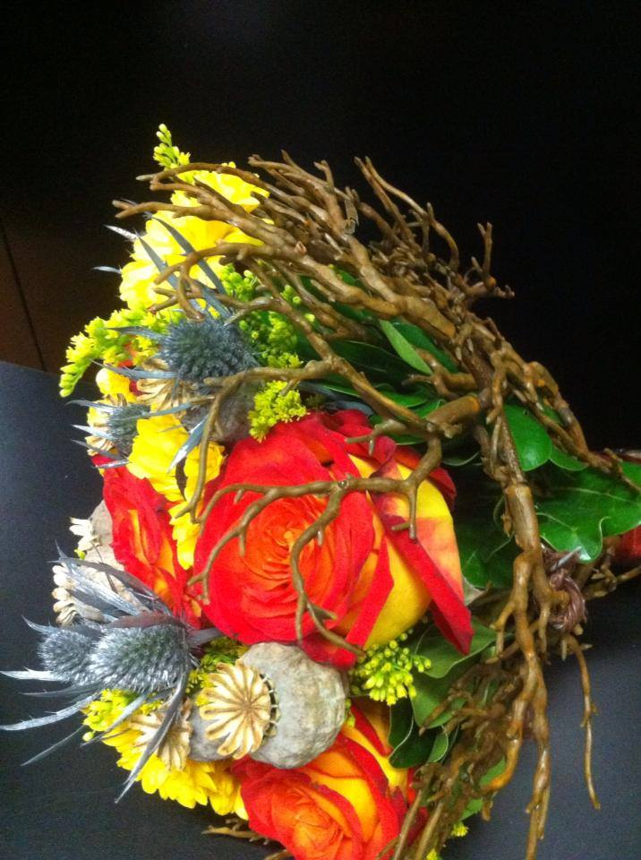 Combining fresh flowers with a silk twig at The Jungle Flower and Gift Store in Saint Paul, AB