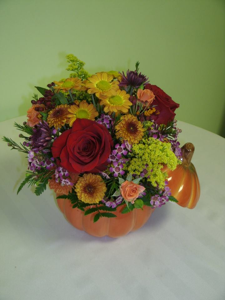 Filling the glass pumpkin at Flowers For You, By Diana in Beeton, ON