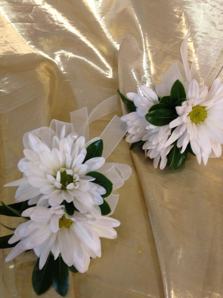 A couple of daisy corsages from River Birch Florist in Locust Hill, VA