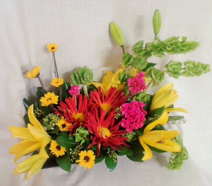 A fresh arrangement for the local restaurant's checkout counter at Marshfield Blooms in Marshfield, MO