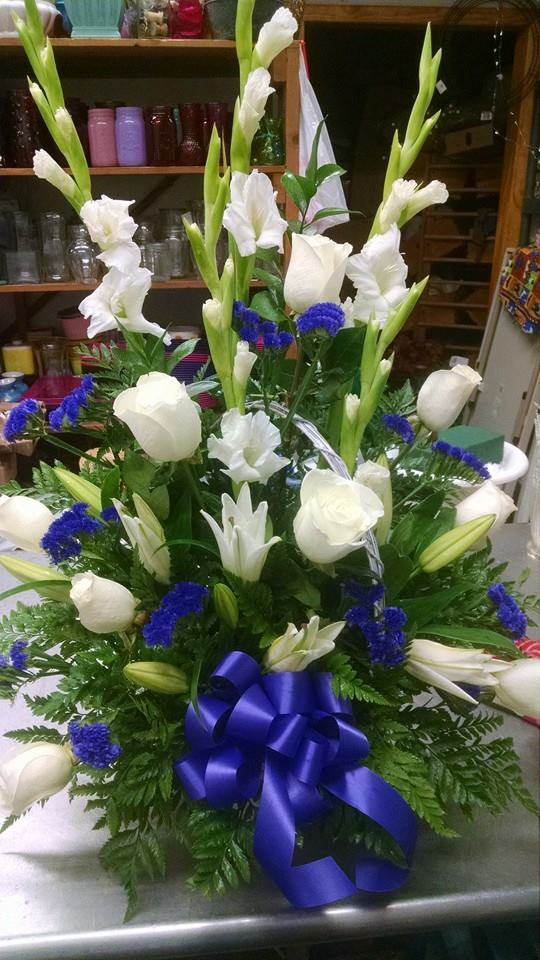 All-white sympathy flowers from Mabel Flowers in Mabel, MN