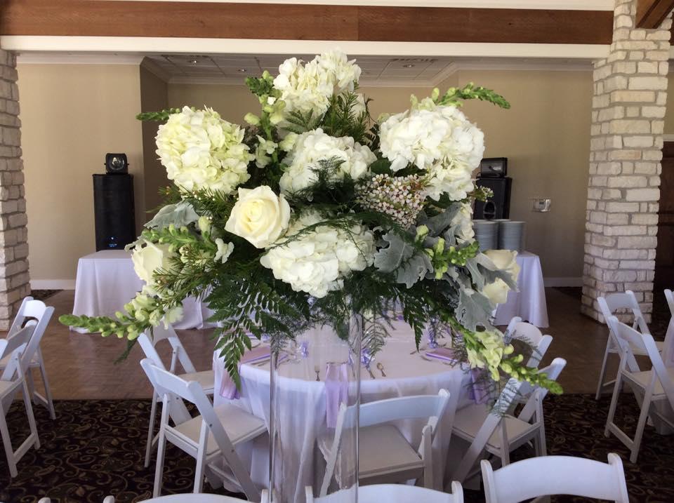 All white wedding by Destry at Brenham Floral Company in Brenham, TX