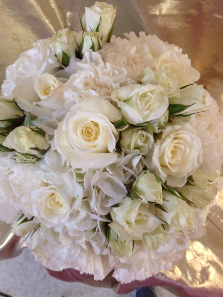 Beautiful white bridal bouquet from River Birch Florist in Locust Hill, VA
