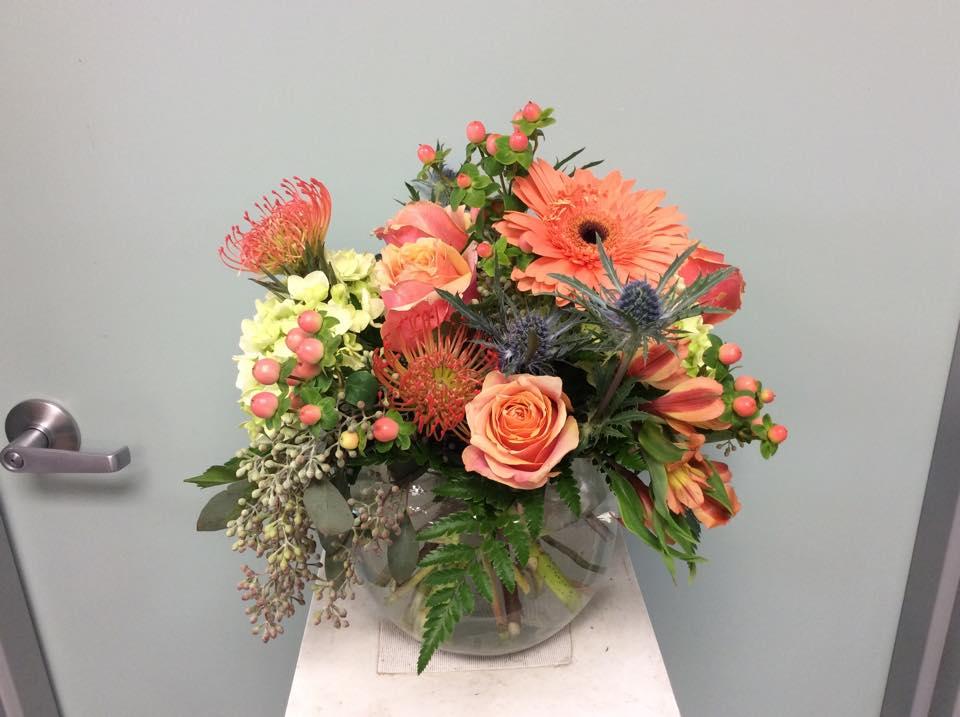 Gorgeous wedding reception flowers by Brenham Floral Company in Brenham, TX