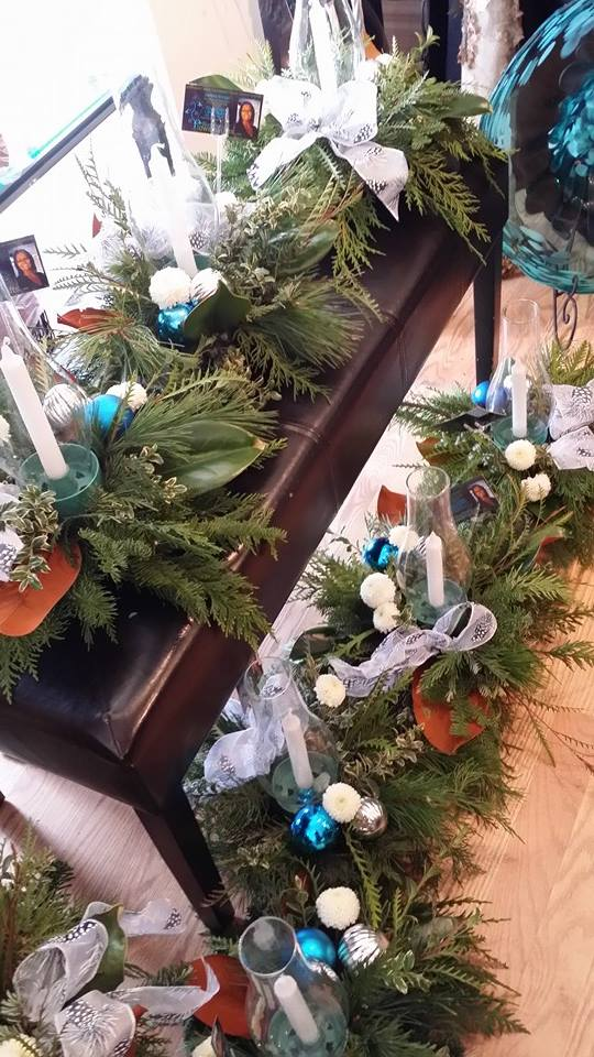 Busting out 20 Christmas centerpieces from BlueShores Flowers and Gifts in Wasaga Beach, ON