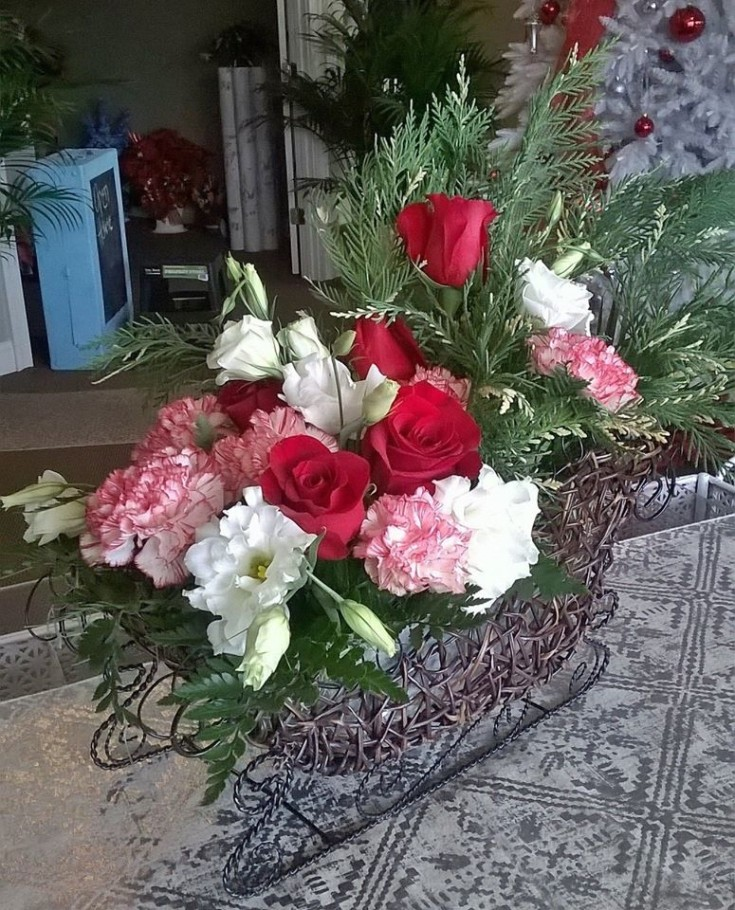 Flowers in an open sleigh from Wilma's Flowers in Jasper, AL