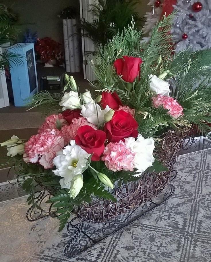 Flowers in an open sleigh from Wilma's Flowers in Jasper, AL