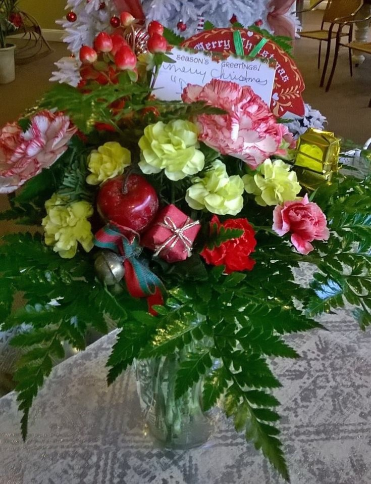 Presents on a present from Wilma's Flowers in Jasper, AL