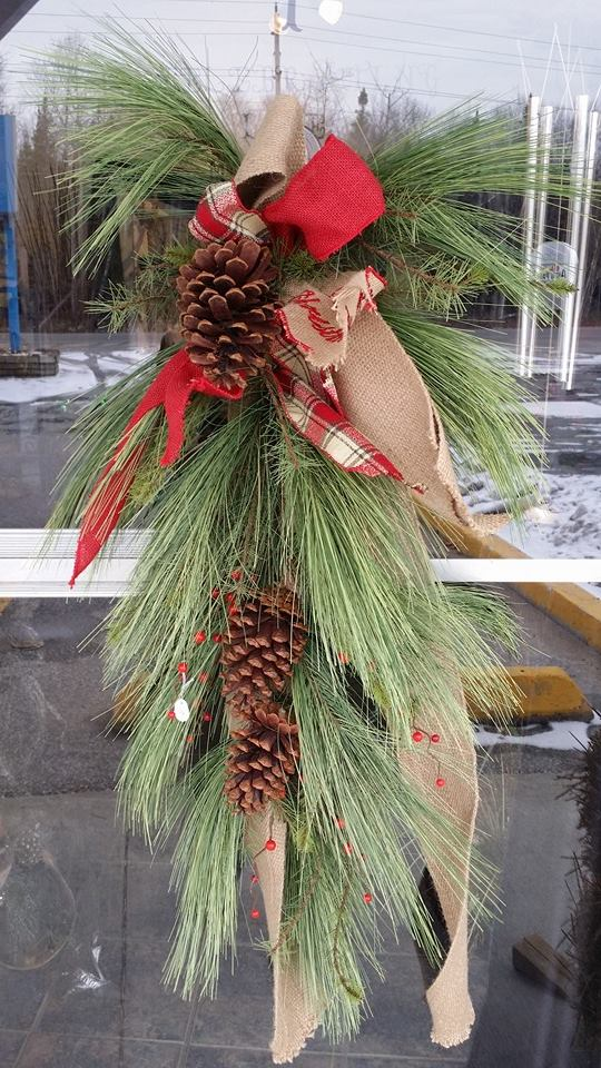 Showing off a Christmas swag at BlueShores Flowers and Gifts in Wasaga Beach, ON