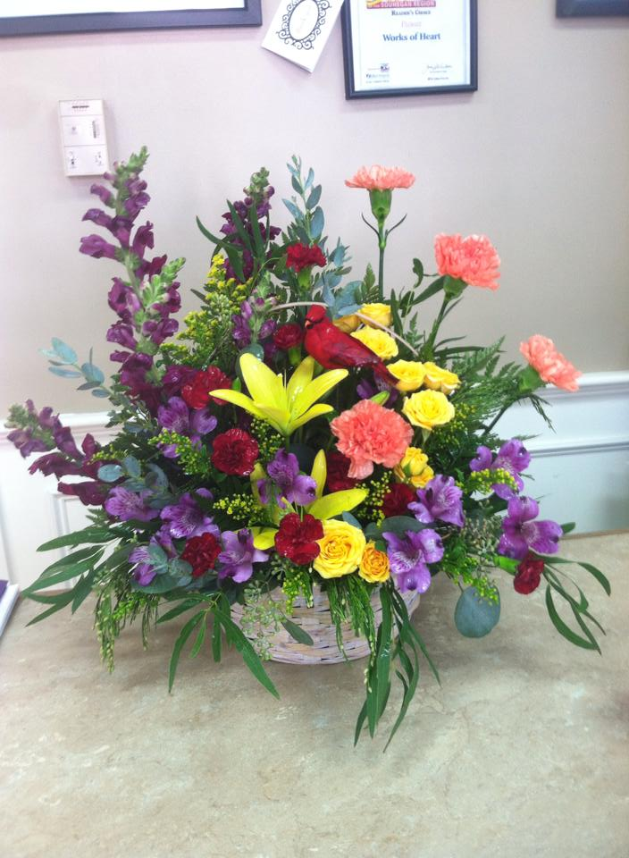 Showing off a bountiful basket with Works of Heart Flowers in Wilton, NH