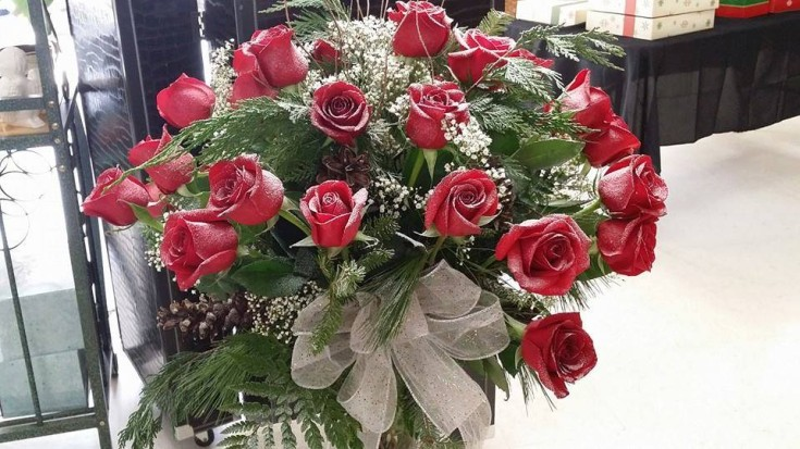 Snow-covered roses by Swannanoa Flower Shop in Swannanoa, NC