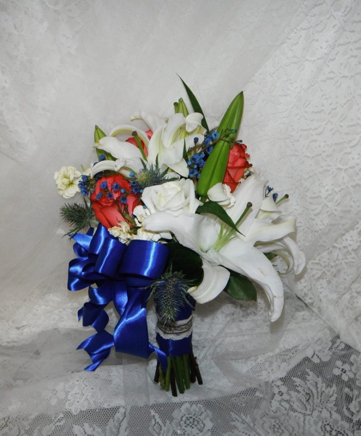 Stunning bouquet with coral, blue and white Oriental lilies from Crow River Floral and Gifts in Hutchinson, MN