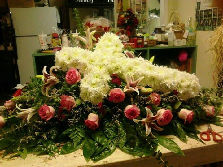 Beautiful casket spray from Front Porch Creations Florist in Crawfordville, FL