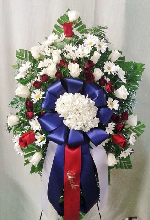 Beautiful standing spray in honor of a life of service to our country from Marshfield Blooms in Marshfield, MO