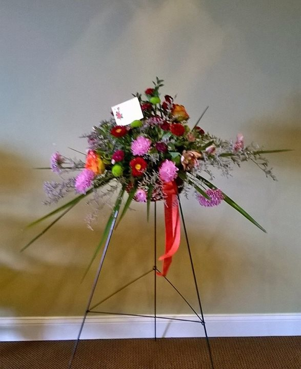 Blooming basket arrangement by Wilma's Flowers in Jasper, AL