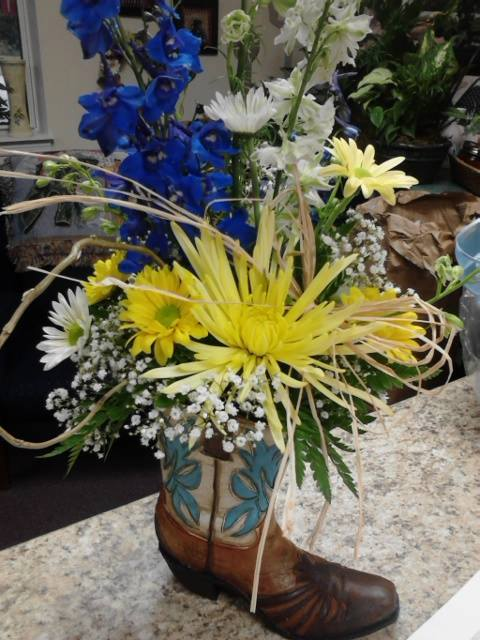 Congratulatory arrangement for a baby boy at Front Porch Creations Florist in Crawfordville, FL