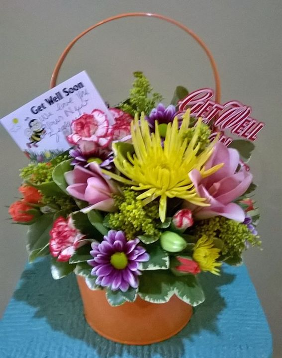 Get well soon floral bucket by Wilma's Flowers in Jasper, AL