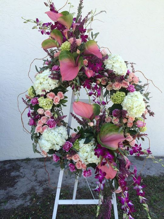 Gorgeous floral wreath by Hobby Hill Florsit in Sebring, FL