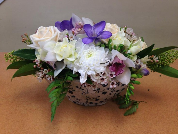 Pastel arrangement with orchid and roses at Oak Bay Flower Shop Ltd. in Victoria, BC
